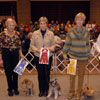 Terrier Group - Pictured from left to right: 1st Place Fanfare Aw-Shucks UD NA NAJ - Border Terrier - Kurt and Mary Ann Lehmann; 2nd Place Southcross Christmas Star UDX RA - Miniature Schnauzer - Louise Botko; 3rd Place CH Belvedere's Sister Parrish UD RN - Norwich Terrier - Joan Jung; 4th Place CH OTCH Begorra Kilkenny Spring UDX4 RE NA NAJ - Irish Terrier - Barbara Lee Henry and Diane Martin