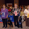 Working Group - Pictured from left to right: 1st Place Ltl Mattie's Touch Of Class UDX AX AXJ - Doberman Pinscher - Joanne and Randy Brettschneider; 2nd Place CH Watermark Sy Bolero UDX6 RAE OA AXJ - Portuguese Water Dog - Kathan Kennedy; 3rd Place CH OTCH Portolano Shoals Of Herring VCD3 UDX5 RE MX MXJ - Portuguese Water Dog - Pam Bartholomew; 4th Place CH Sunchase's Texas Margarita UDX RN - Boxer - Peggy McConnell